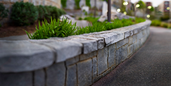 Stone Work Retaining Wall On Lawn