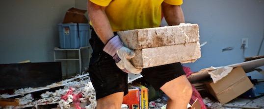 Strong Man Lifting Concrete Blocks