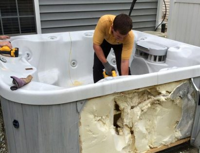 Old Hot Tub Being Cut By Saw