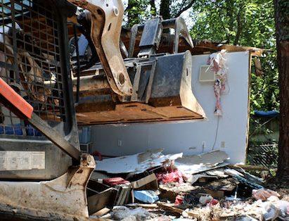 Bobcat Tearing Down Small House