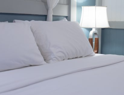 Crisp, white linens on bed