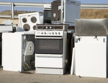 Broken and unused appliances in a dump